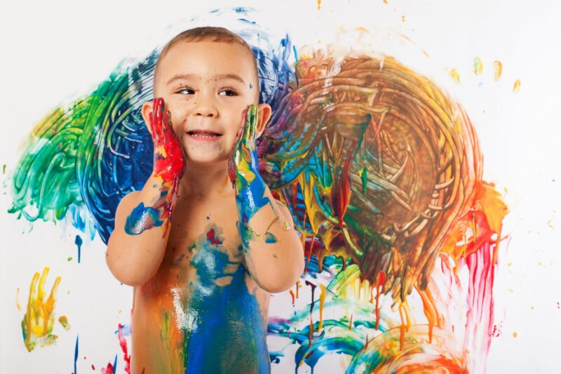 Cute baby covered in paint - Name individuality