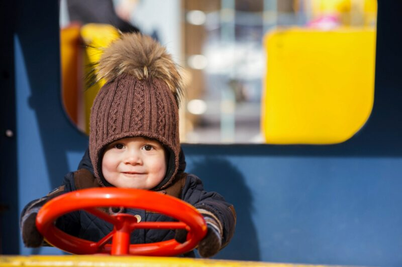 Cute little boy pretending to drive - Scottish baby names for boys