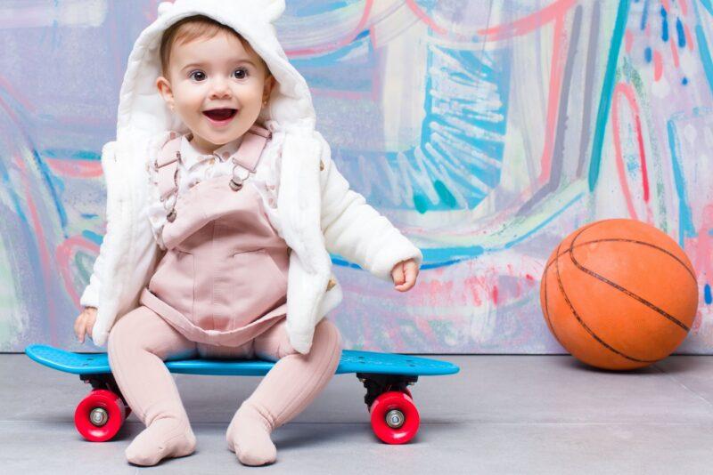 Cute little girl on skateboard - Scottish baby names for girls